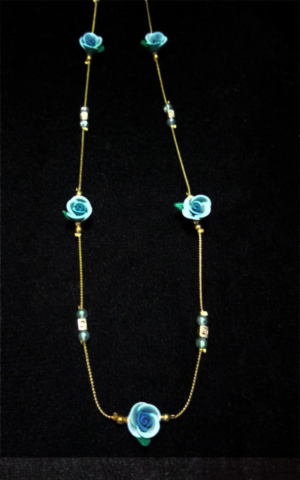 handmade blue clay flower and gold bead necklace