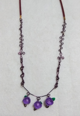 handmade Purple wire twist and clay flower bead necklace
