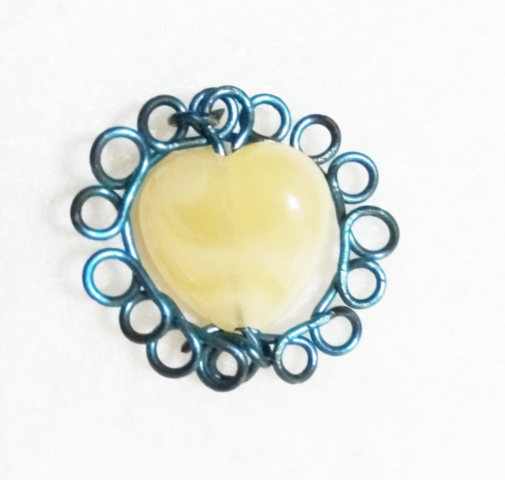 handmade Blue wire twist and pearl heart bead pendent