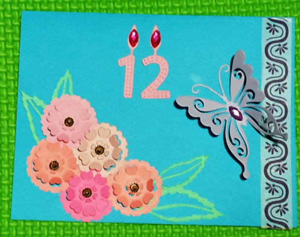 Die cut heart flowers with leaves  and 3D die cut butterfly birthday card.