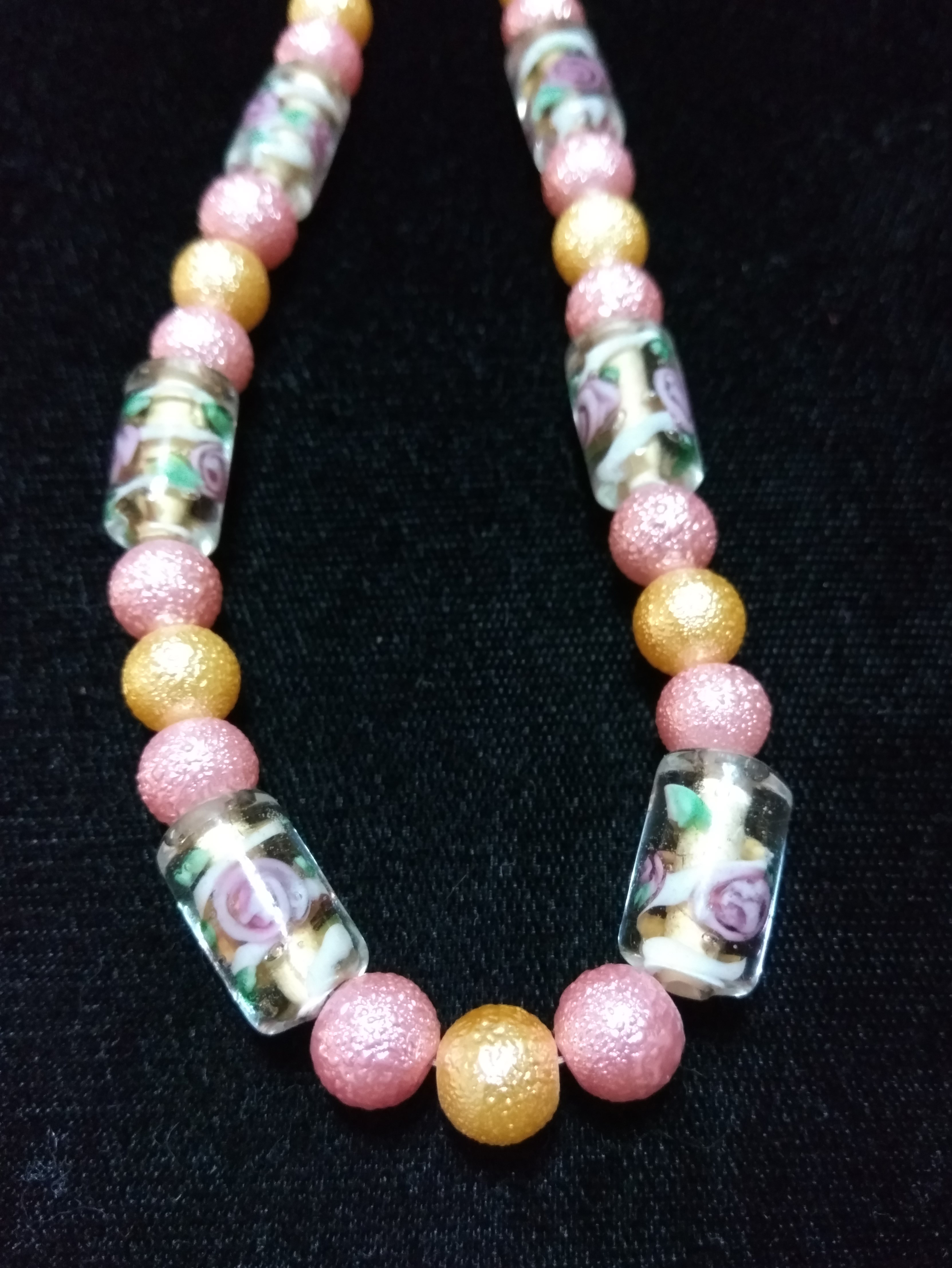 handmade pink and gold pearl bead necklace with clear purple flower bead