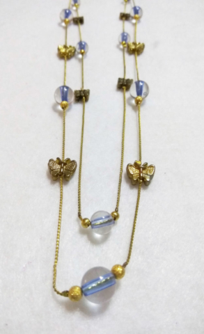 handmade two tier Gold butterfly and blue glass bead necklace