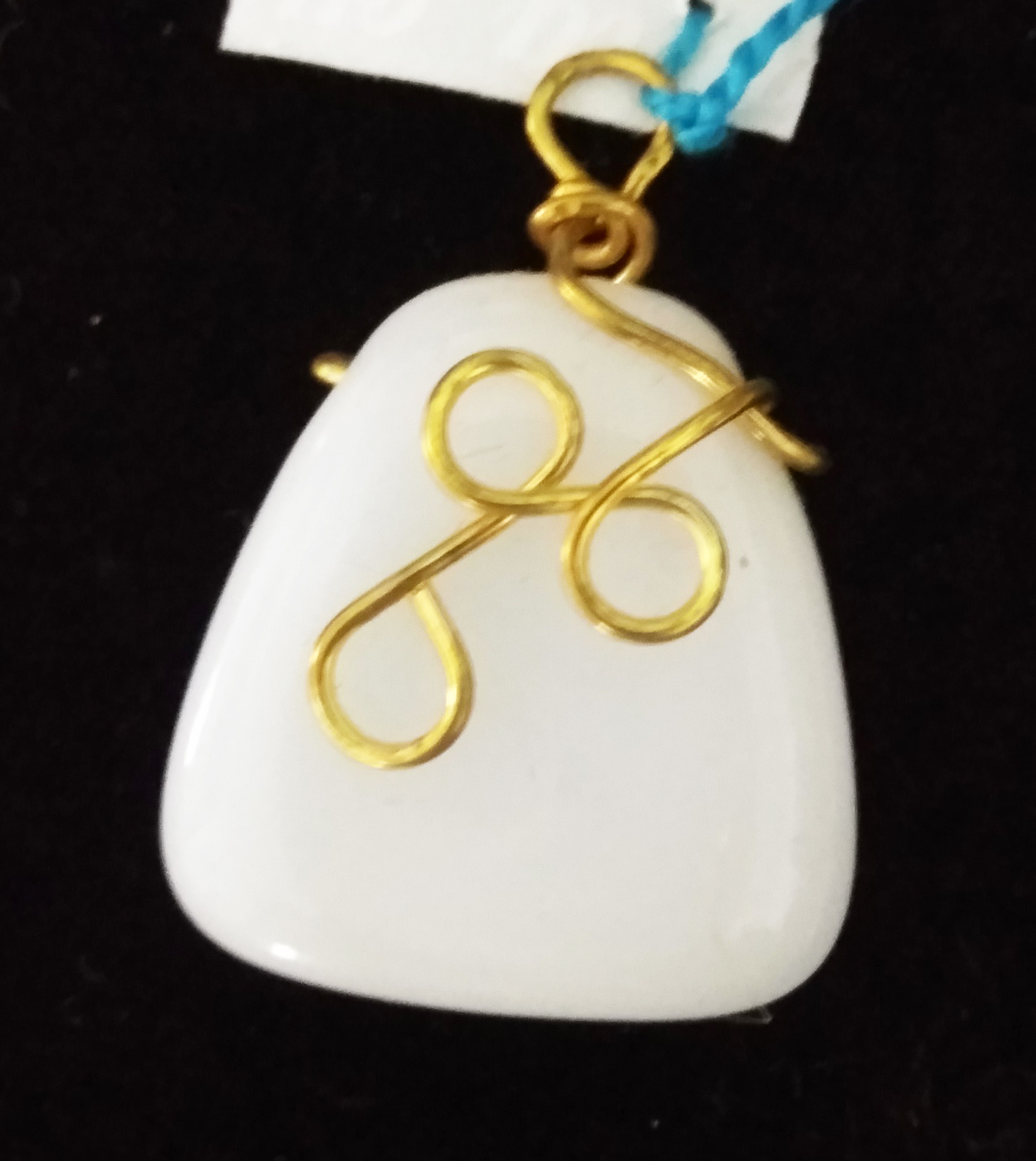 handmade White and gold wire twist pendant