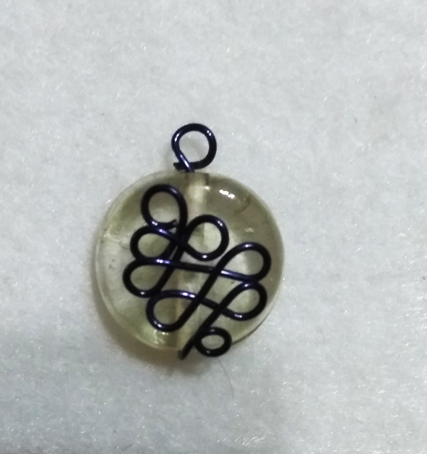 handmade Clear bead with blue wire twist pendant