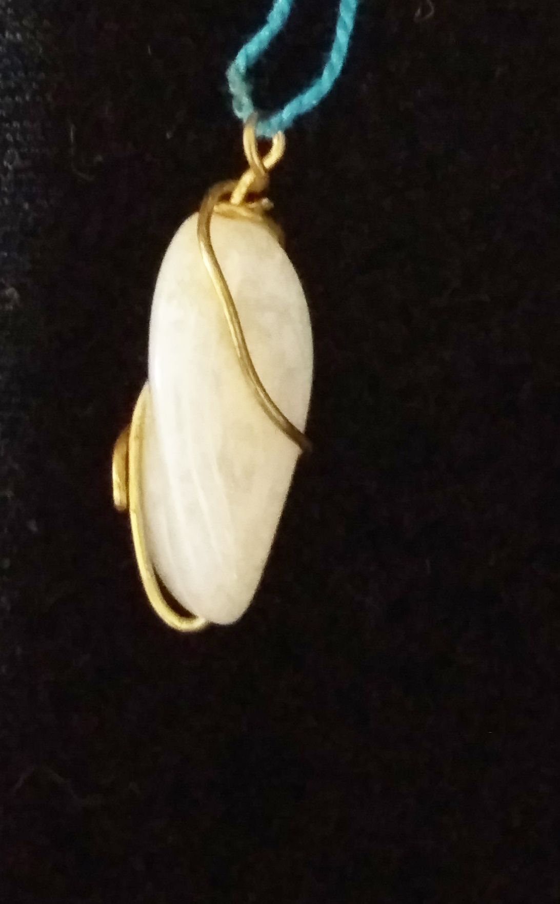 handmade White stone and gold wire twist pendant